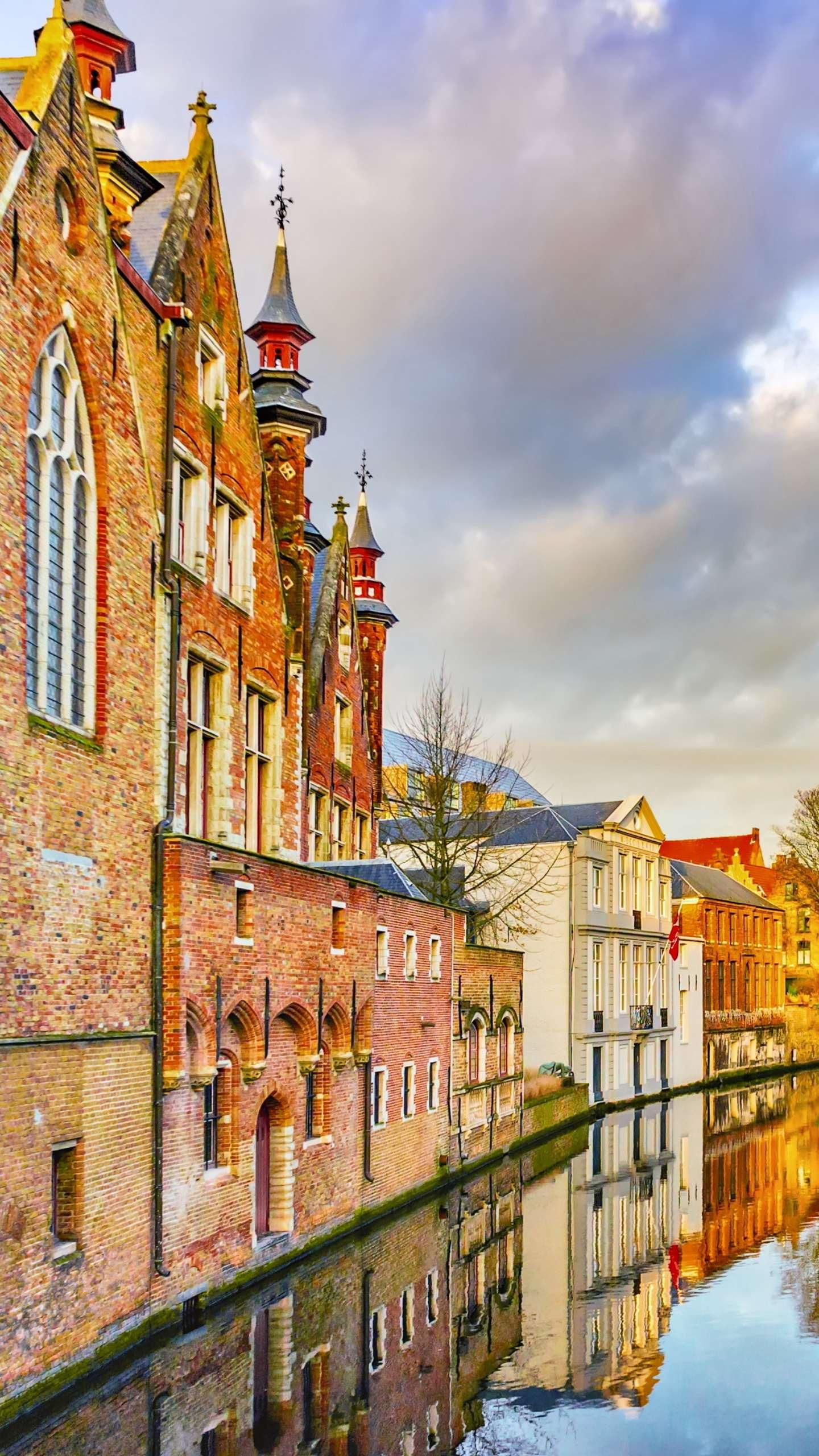 The tranquility of the Old Town of Bruges. This European city is a dream water town with a canal in every corner of the city.