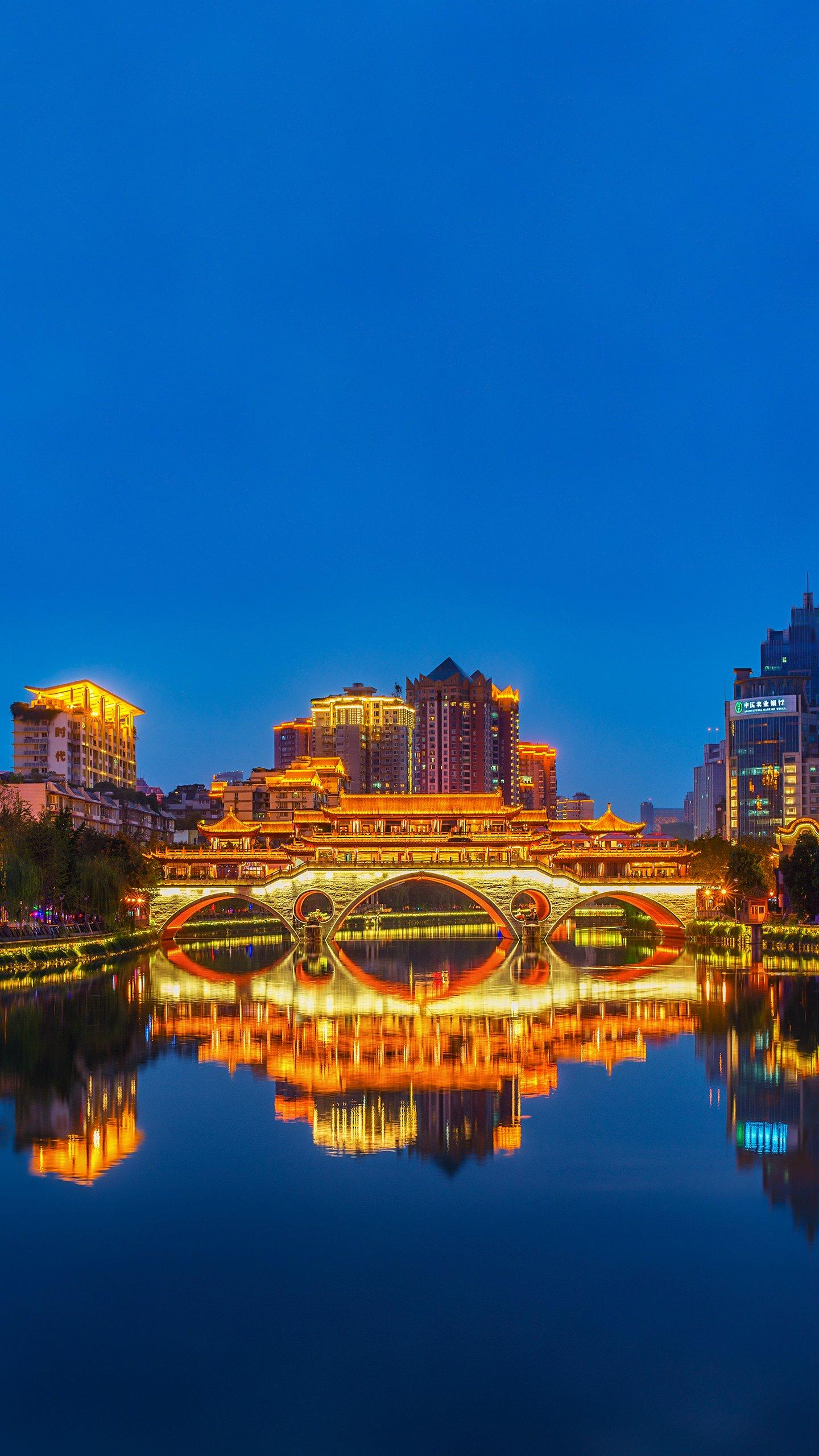 Chengdu - Anshun Covered Bridge. The bridge deck and the red wall of the archway, the cornice, the curved porch, highly concentrated the essence of Chinese national architectural style.