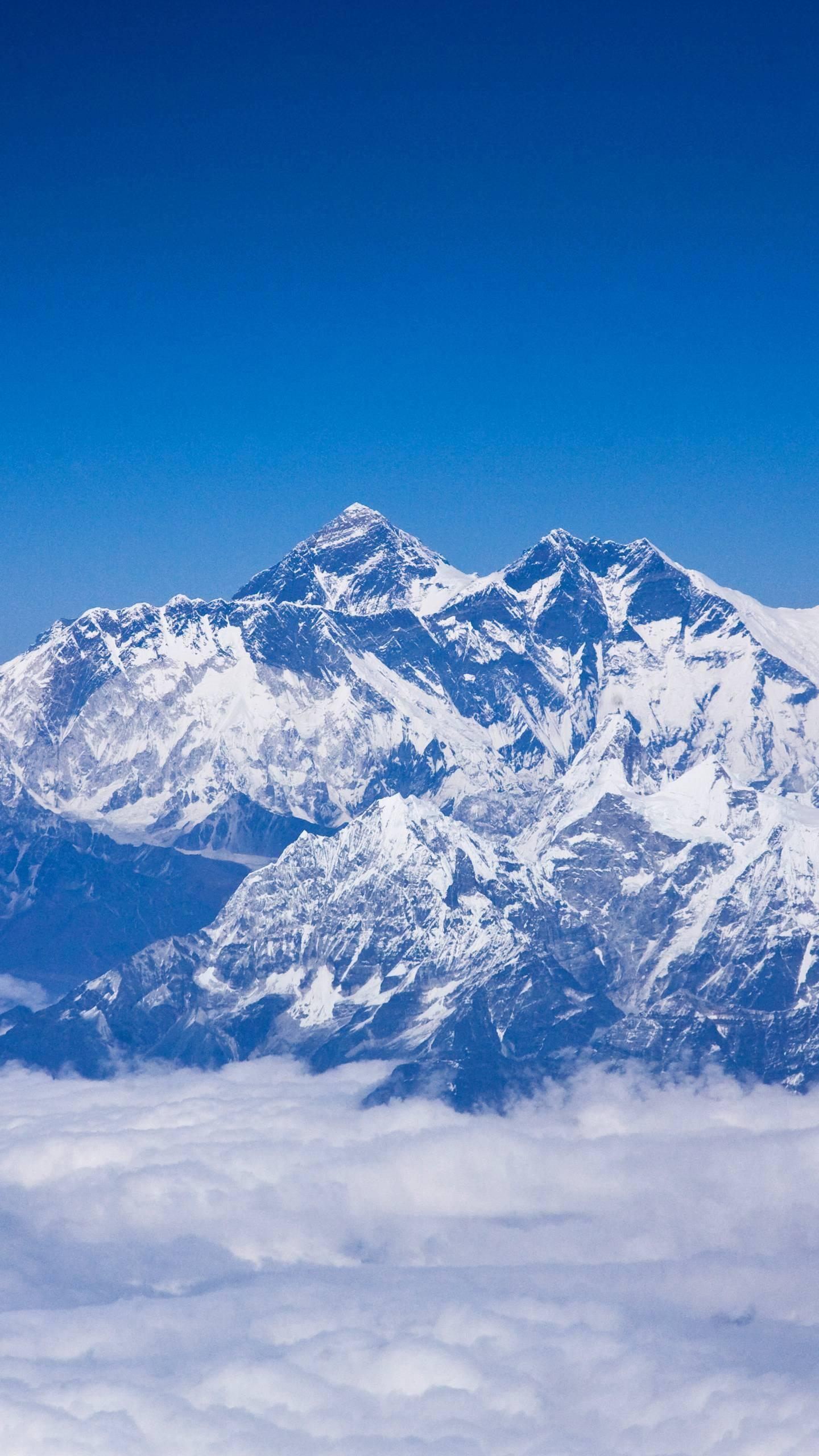 The other highest peak in the world. Mount Everest is very high, but it is not the farthest point from the Earth. It is because of the shape of the Earth itself.