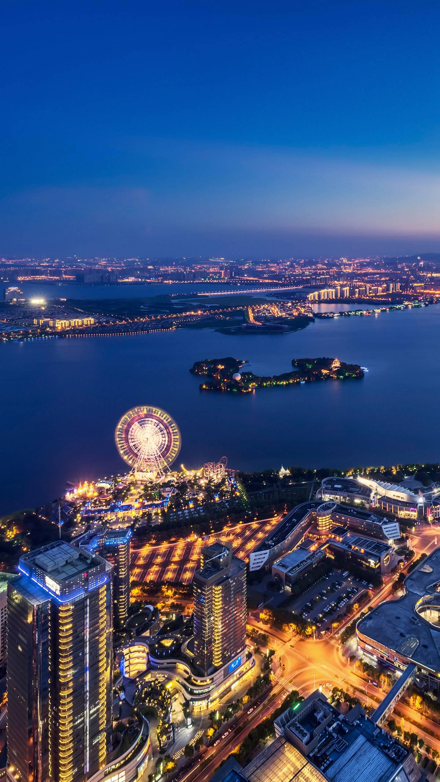 Suzhou - Golden Rooster. Jinji Lake is a beautiful and bright place in the industrial park. It is shining and sparkling at night.