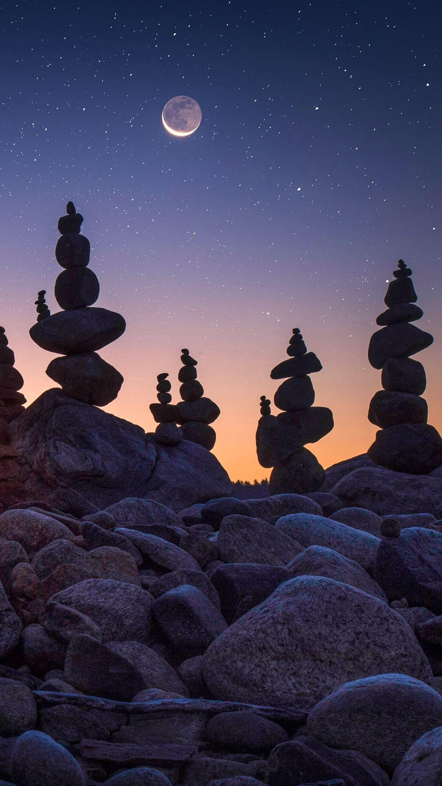 "Stack stone art. The process of establishing balance in stone is like ""practicing yoga"", showing the beauty of tranquility and far-reaching nature."