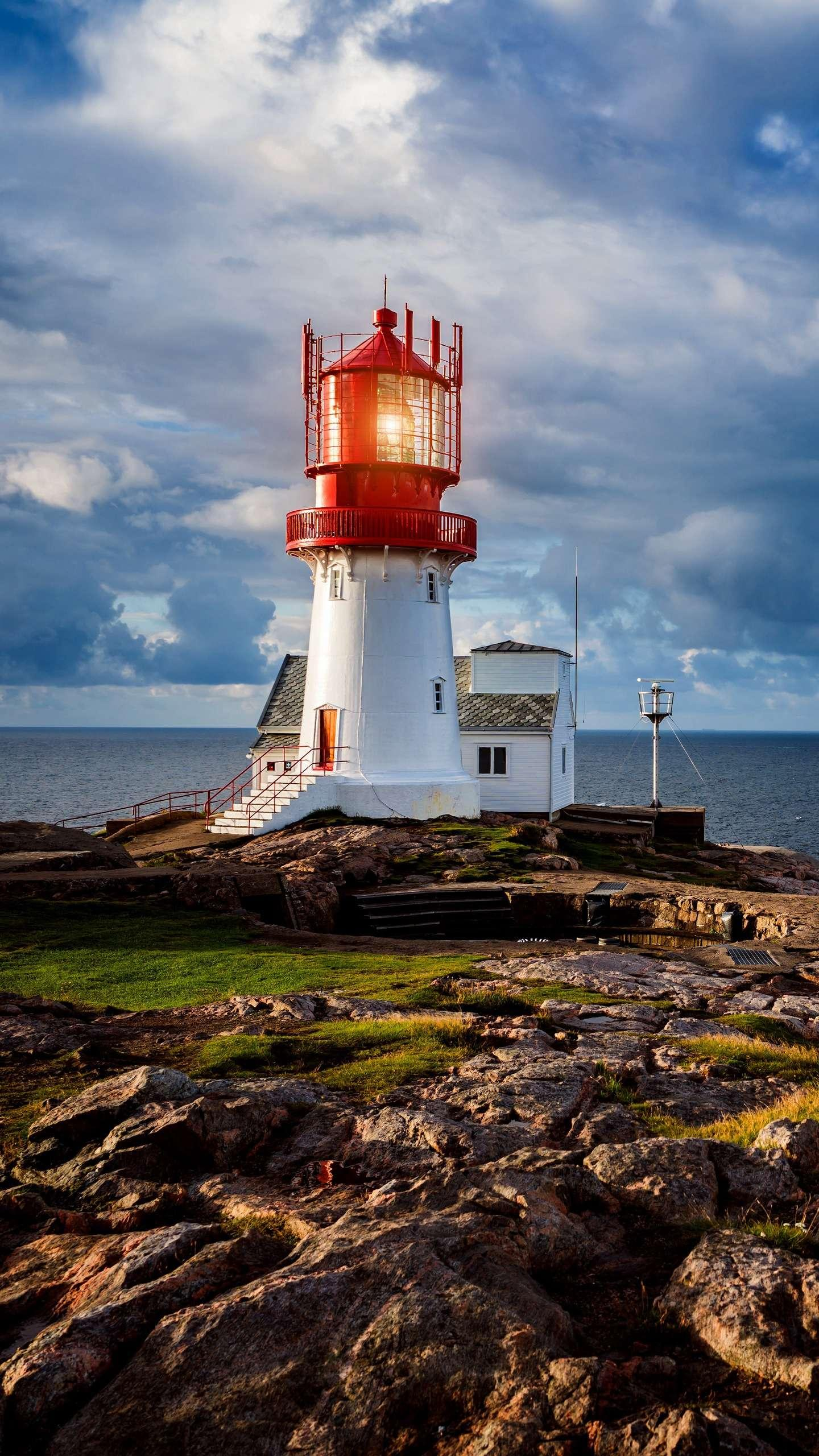 Beautiful lighthouse. The lighthouse guides the passing ships in the dark, no matter how cloudy or sunny, it has been silently witnessing the changes of the years.