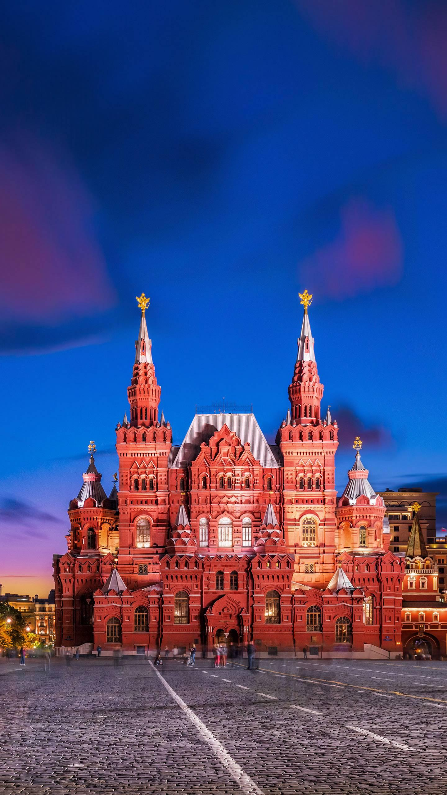 Russian National History Museum. The elegant red brick building stands tall with silver-white spires, highlighting the Russian architectural style in a calm and restrained temperament.