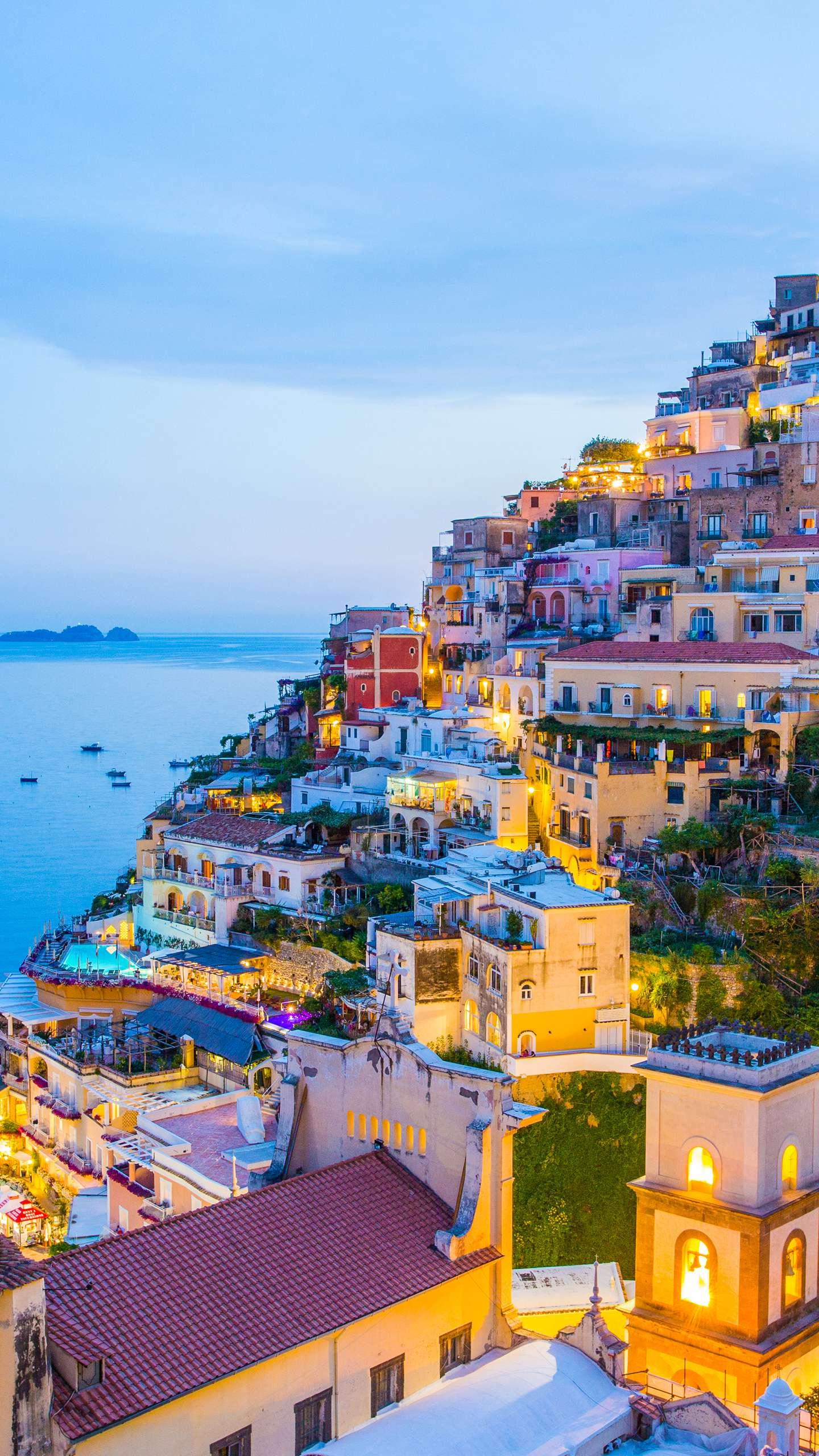 Italy - Positano. The houses in the small town are covered on a cliff. They are small and exquisite, and they are beautifully contrasted with the blue water.