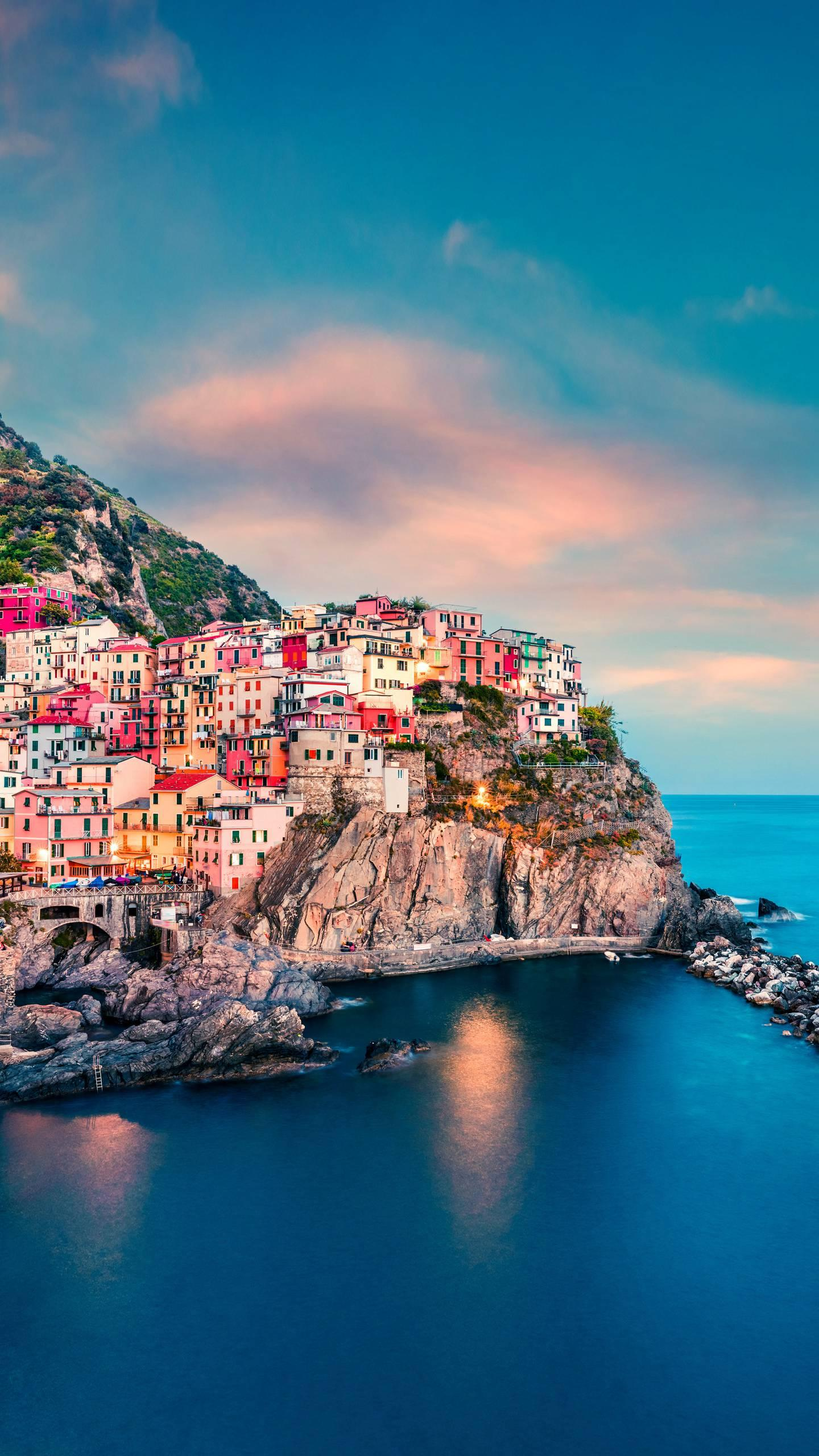 Italy - the Cinque Terre. The colorful houses are situated on the cliffs, like colored gems dotted between the green hills and the sea.