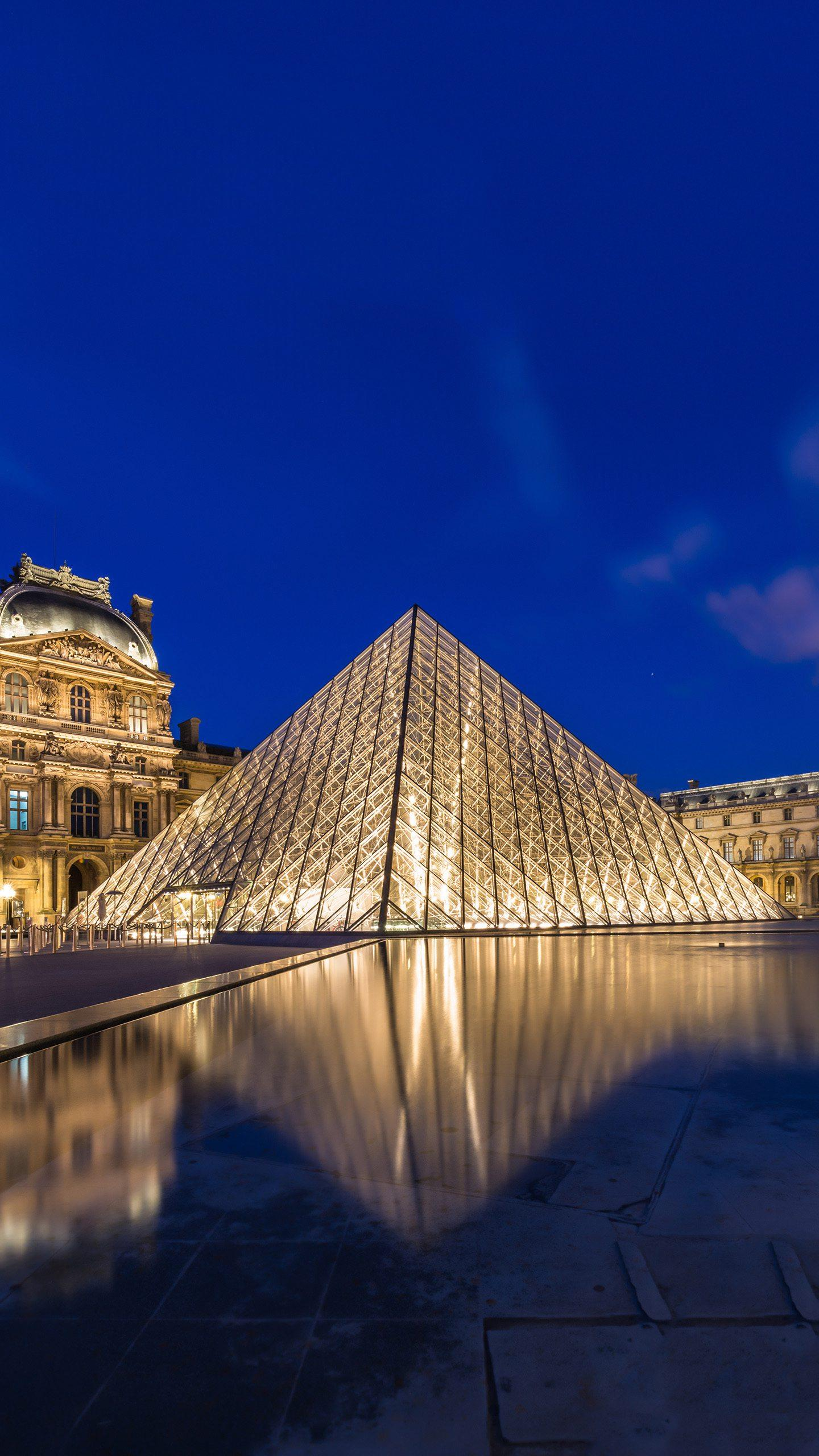 Paris - Louvre. The glass pyramid designed by Pei Ming has become a symbol of the Louvre, adding a new dazzling brilliance to the city of Paris.