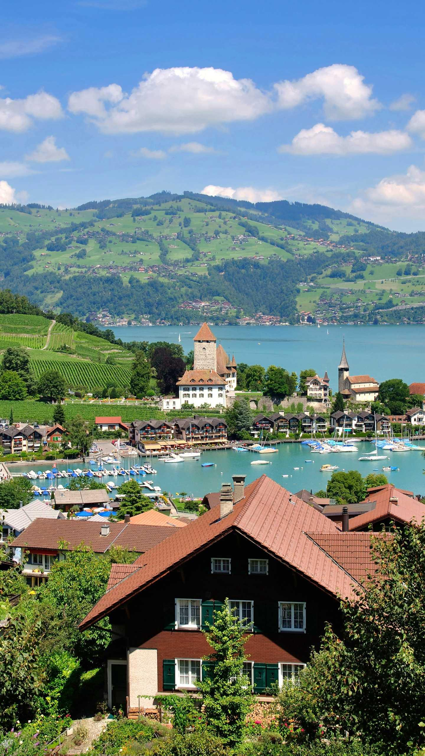 The town of Spiez, Switzerland. The small town of Spiez is like a mirror, surrounded by snow peaks and fresh air. It is a famous resort for recreation and water sports in Switzerland.